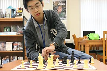 Eighth grader George Zhou snags rank in top 25 chess players of United States