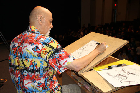 Perez sketches his beloved characters in front of the student audience before his talk back session.