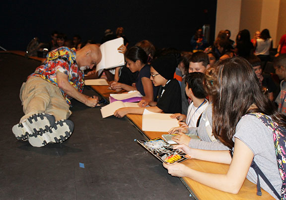 Cartoonist George Perez signs autographs after his talk back session.