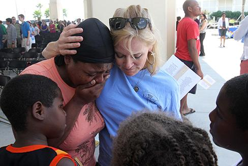 Anne Warren of Gulfport, Miss., right, prays with April Moore of Gulfport after the 10 Years, 10,000 Reasons Hurricane Katrina remembrance service at Barksdale Pavilion in Jones Park in Gulfport on Saturday, Aug. 29, 2015. Moore, who said she lost everything in Katrina, was overcome by memories of the storm. (John Fitzhugh/Biloxi Sun Herald/TNS)
