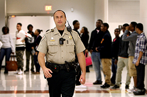 Shelby County Sherrif's Department SRO Joseph Fox wears a personal body camera while on duty on Oct. 15, 2014, at Southwind High School in Memphis, Tenn. (Stan Carol/The Commercial Appeal/TNS)