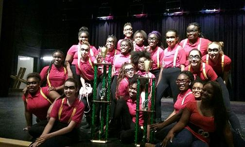 Bak's 2016 Step Team displays their two awards they won on April 2, 2016.