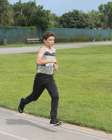 Aidan Nelson, eighth grade visual major, practices for the 100m run. His next competition was against Duncan on May 17, 2016.