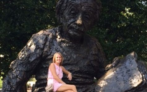 Tracy Smith sits on the Albert Einstein Memorial in Washington D.C. after touring the city. Smith visited several national landmarks after receiving her award.
