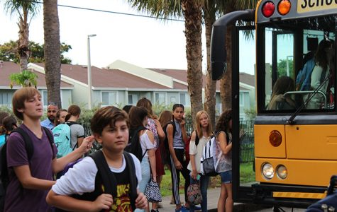 Students off load their buses to start a new school year at Bak MSOA.