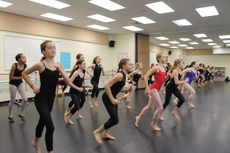 "Practice makes perfect for dancers as they warm up to prepare for their class. Bak offered classes in ballet, modern, jazz, and many more. ""Dance makes me feel beautiful,"" Ria Barnes, seventh grade dance major, said. ""I love the emotion I get to put into it."""