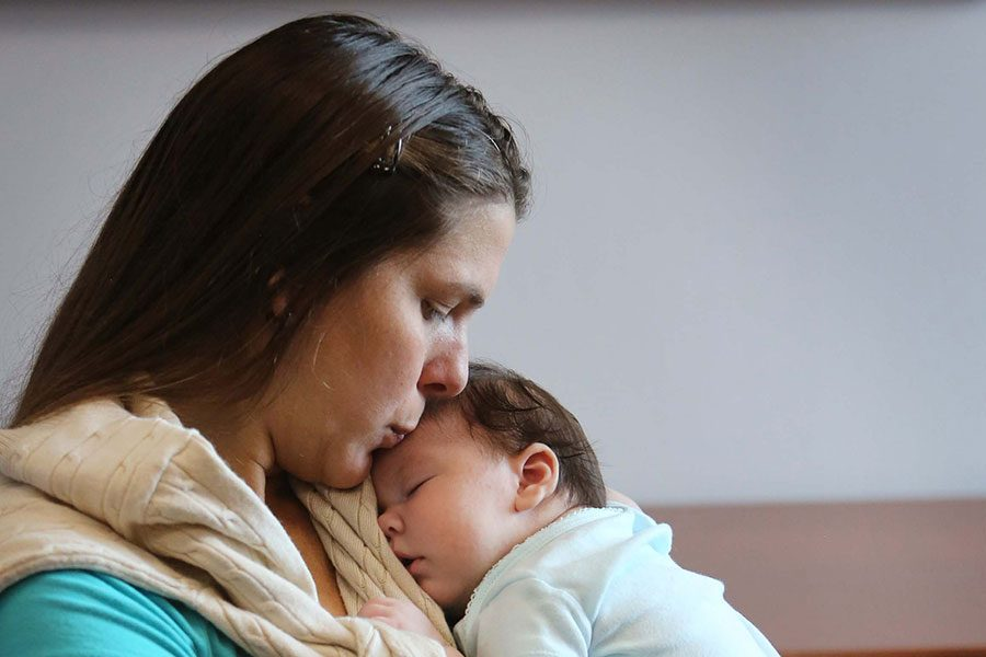 Maria Ramirez Bolivar, a Venezuelan woman who lives in Doral but contracted Zika in her first trimester while traveling in Venezuela, holds her baby girl, Micaela Milagros Mendoza, 2-months, on Aug. 24, 2016. Micalea has Zika-related calcification in her brain and scarring in her retinas.