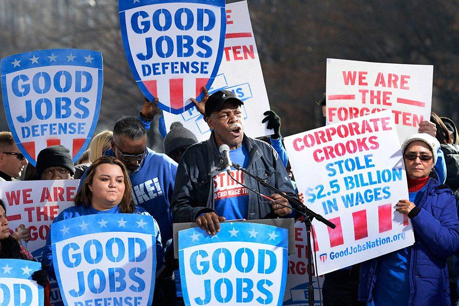 Actor Danny Glover joins striking federal contract workers during their rally to hold President-elect Donald Trump accountable to keeping his promise to workers Dec. 7, 2016 in Washington, D.C.