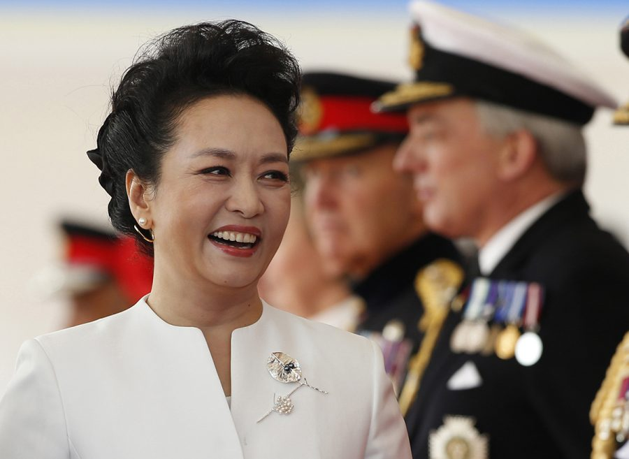 Chinese first lady Peng Liyuan greets dignitaries during the official welcome ceremony at Horseguards Parade on the first official day of the Chinese state visit in 2015 in London. (Alastair Grant/PA Wire/Abaca Press/TNS)
